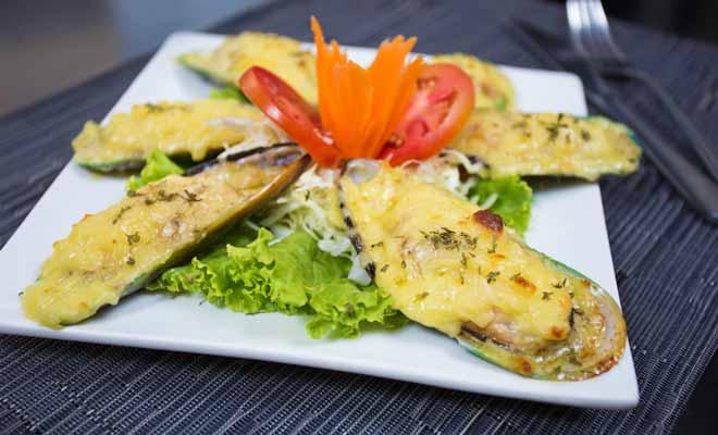Les greens mussels qui sont des moules vertes gigantesques, font partie des fruits de mer que vous pourrez déguster en Nouvelle-Zélande.