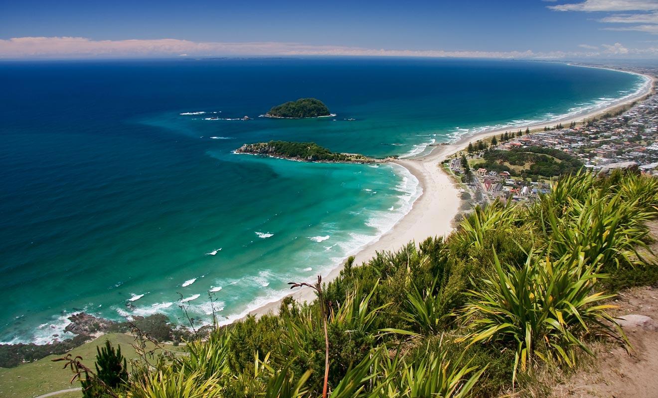 Les plages de l'île du Nord attirent les baigneurs durant les mois d'été.